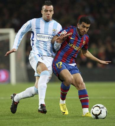 El Málaga está a punto de dar la sorpresa en el Camp Nou, pero cae en el tramo final del partido. / AFP · EFE · Reuters