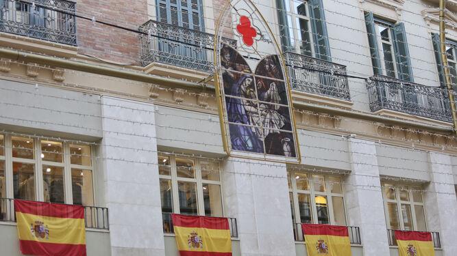 Varias de las banderas en los balcones de calle Larios.