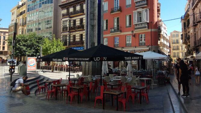 Imagen de archivo de las terrazas instaladas en la Plaza Uncibay, en el Centro de Málaga.
